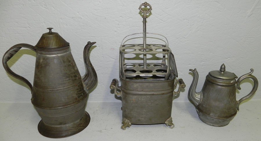 7: (2) early tin tea pots and  metal bottle sterilizer.