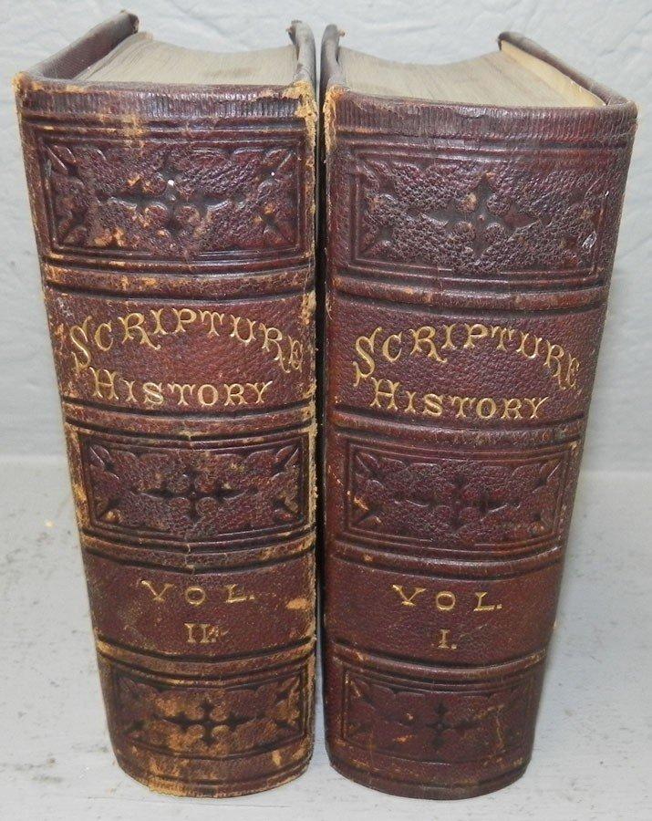 23: (2) leather bound books