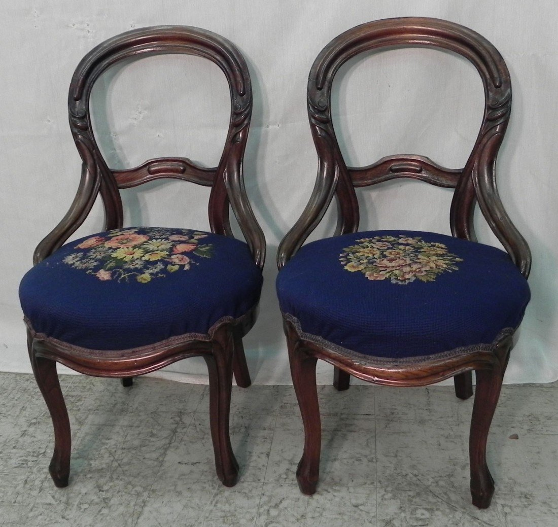 7: Pair of needlepoint Victorian side chairs.