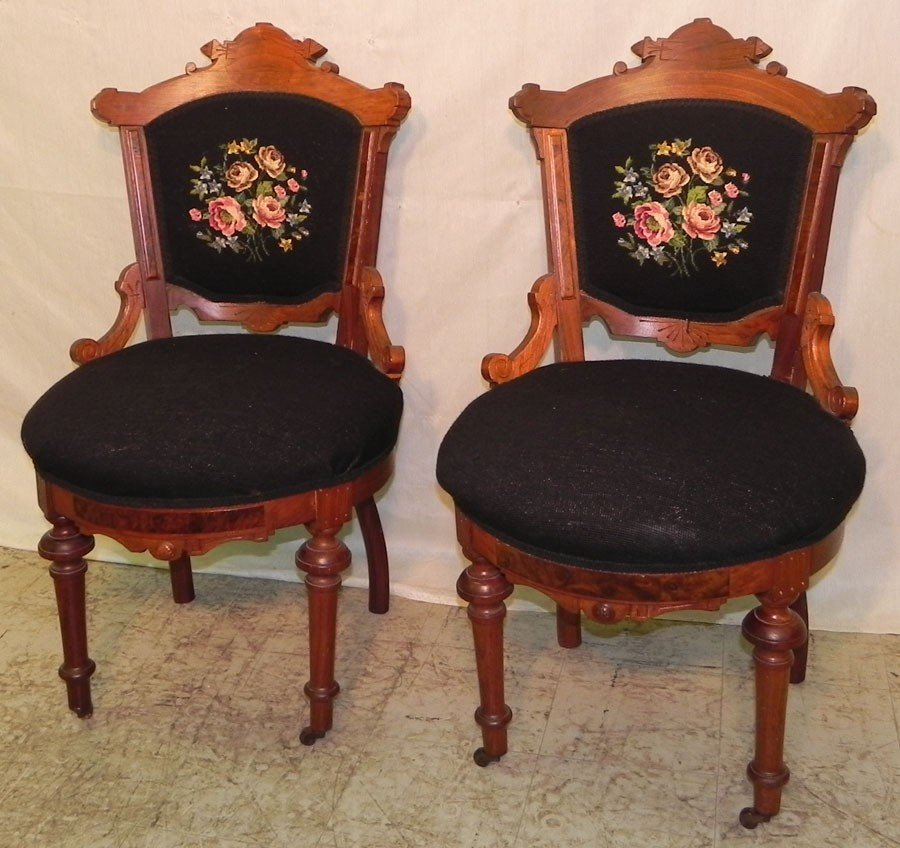 17: Pair of carved walnut needlepoint side chairs.