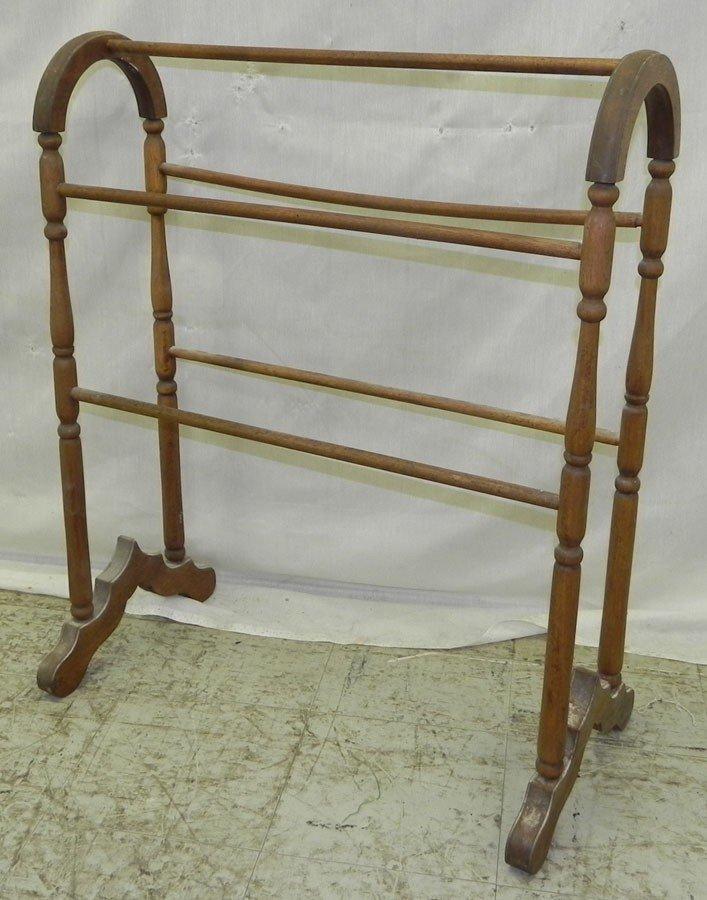 20: Walnut towel rail.
