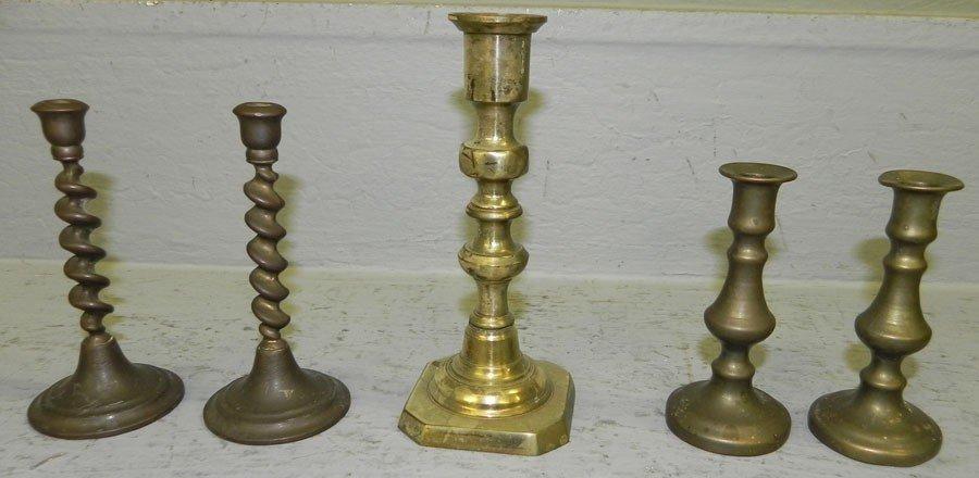 4: (5) miniature brass candlesticks.