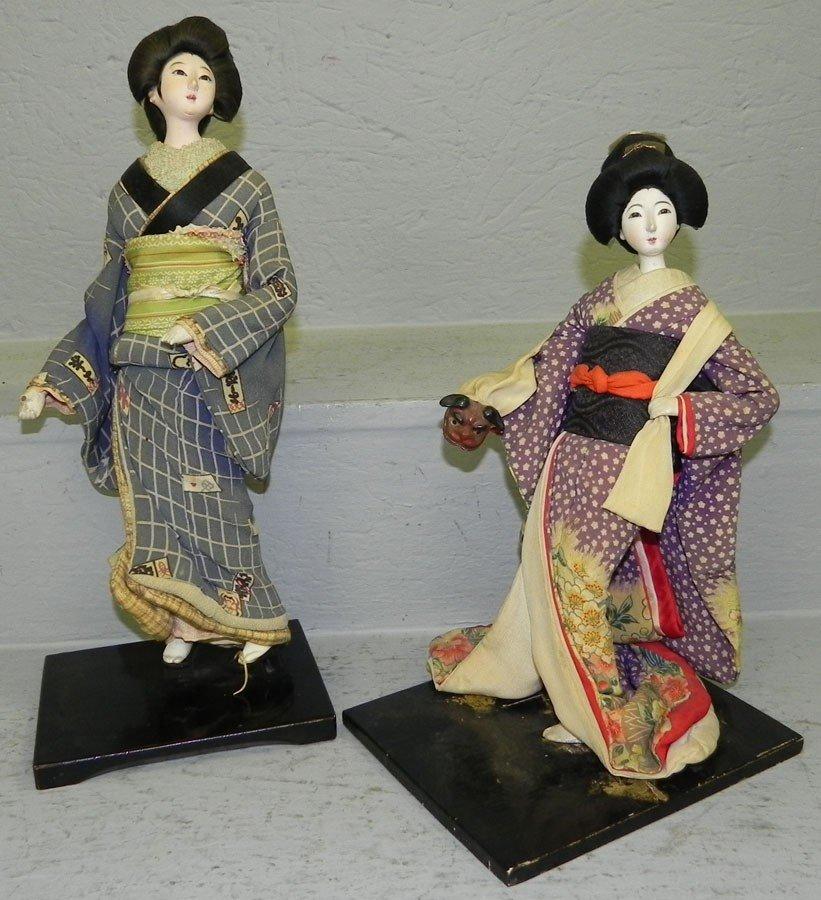 9: (2) bisque head Oriental geisha dolls