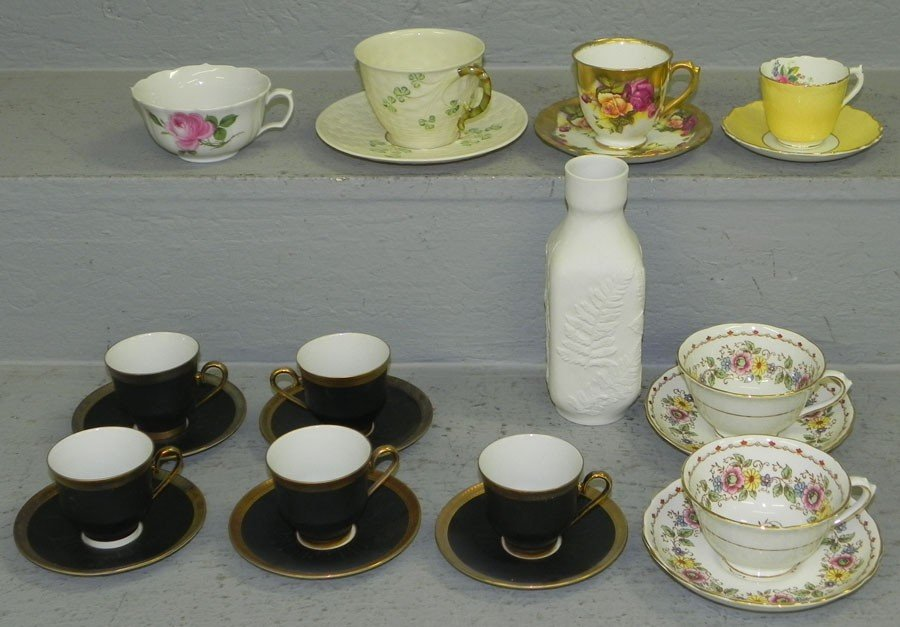 18: Collection of cups, saucers and vase.