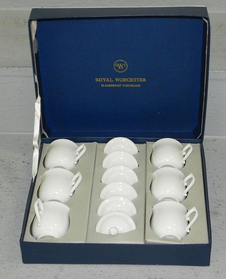 22: Royal Worcester pot de crème set.