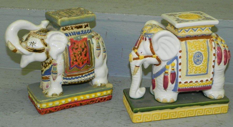 24: (2) pottery miniature elephants.