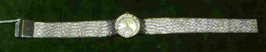494 18K WG Omega ladies watch w diamond bezel