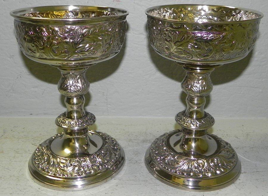 4: (2) silver plate candlesticks with chalice inserts.