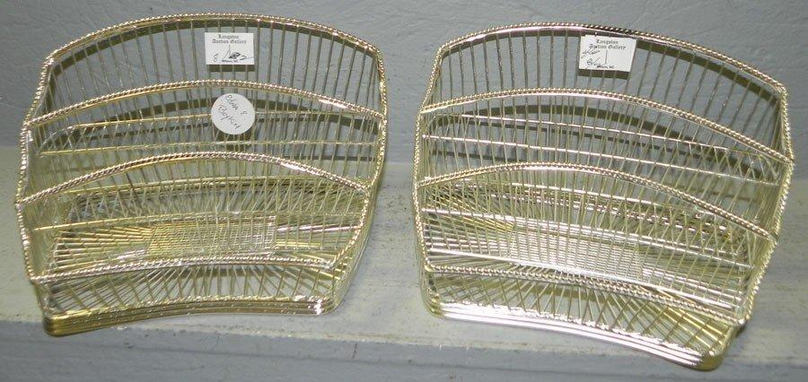 8: (2) silver plate bread or cracker baskets.