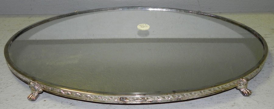 10: Footed silver plated mirrored plateau.