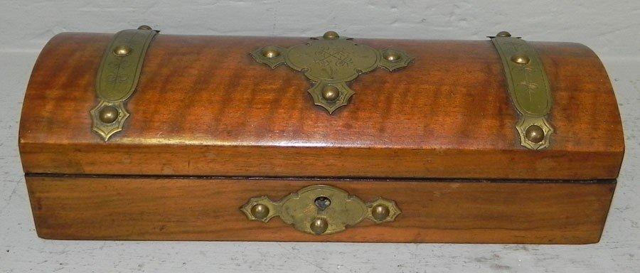 57: Mahogany dome top brass bound dresser box.