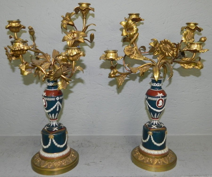 63: Pair of bronze and porcelain French candelabras.