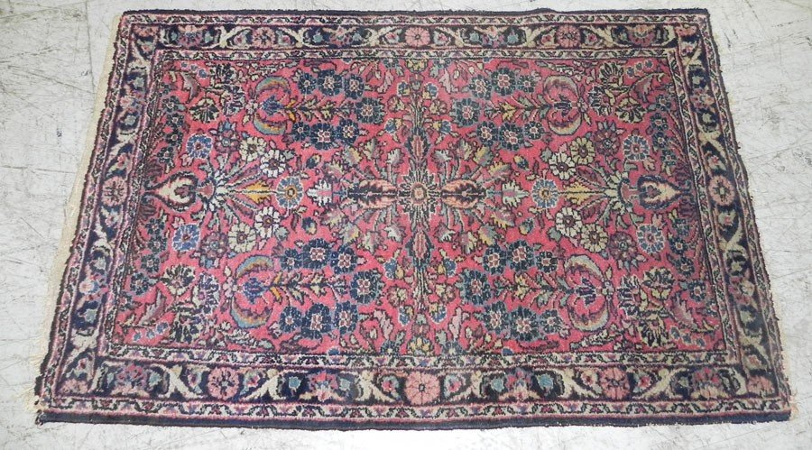 "69: 3'8"" x 4' 2"" handmade Persian rug."