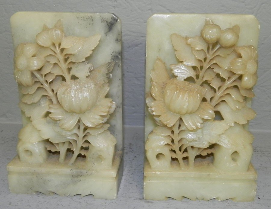 71: Pair of carved alabaster bookends.