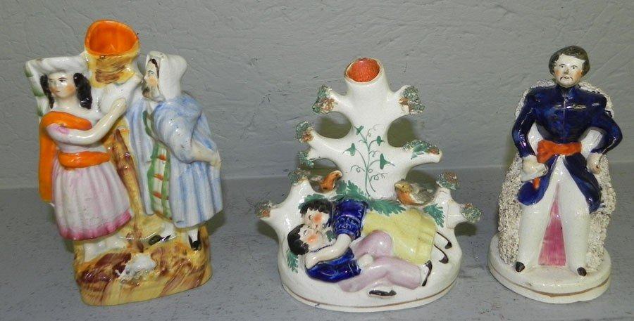 76: (3) 19th century Staffordshire figurines.