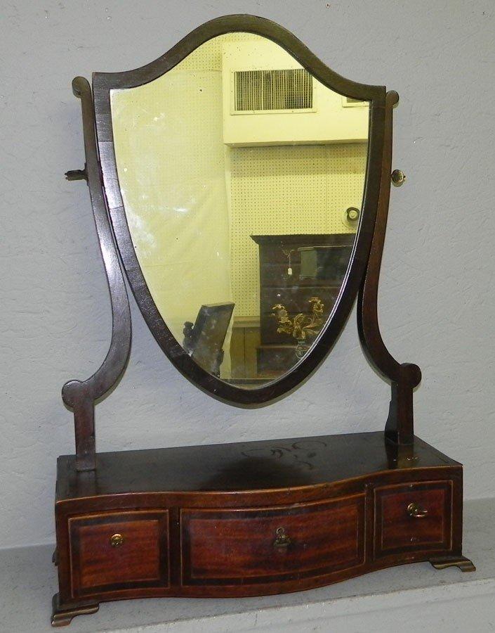 89: Hepplewhite serpentine front dressing mirror.