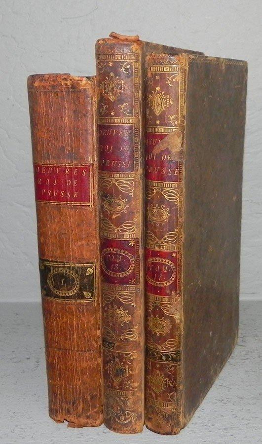 97: (3) leather bound books