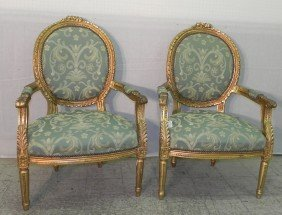 Pair Of  French Decorator Gilt Arm Chairs.