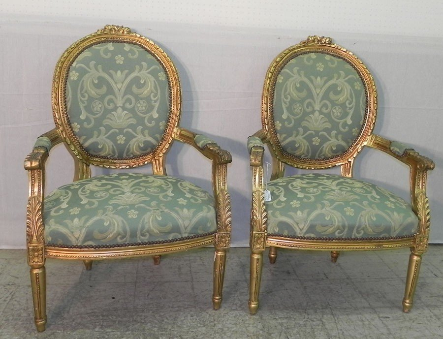 98: Pair of  French decorator gilt arm chairs.