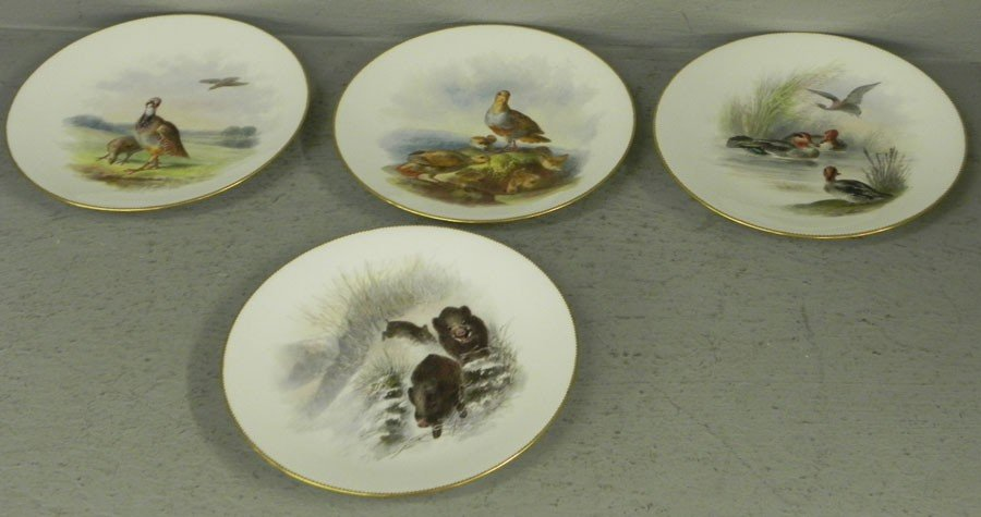 100: (4) hand painted wild life plates by Minton.