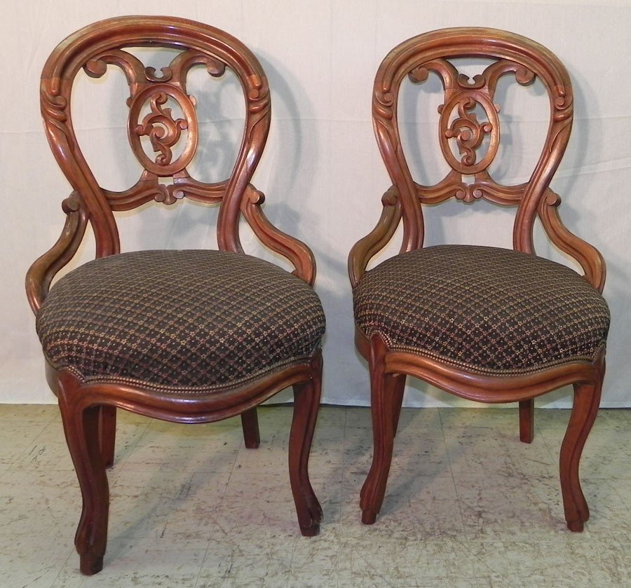 108: Pair of Victorian hip rest walnut side chairs.