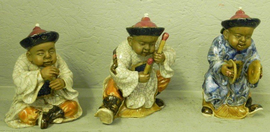 112: (3) mud figurines of musicians.