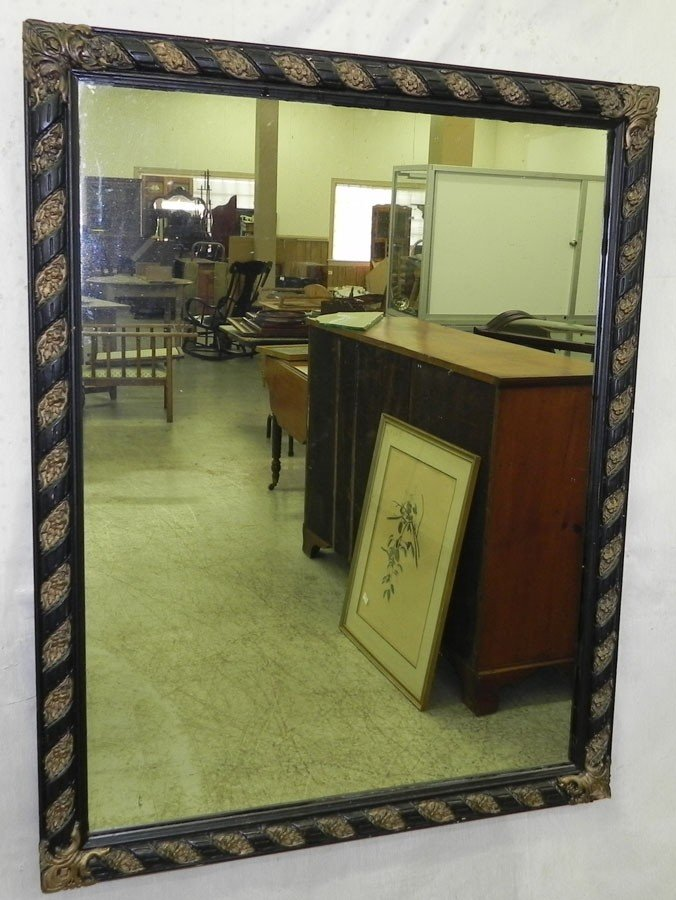 152: Decorated frame mirror