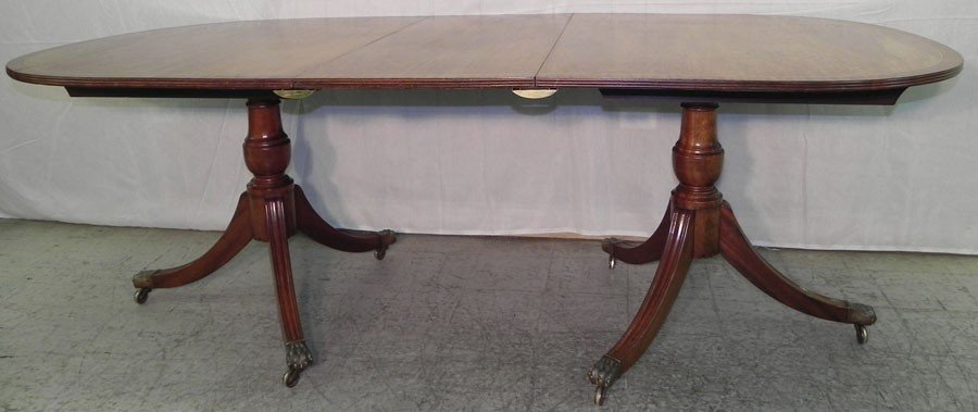 164: Two pedestal mahogany inlaid dining table.