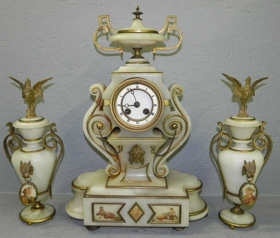 401: French alabaster clock set with bronze trim.