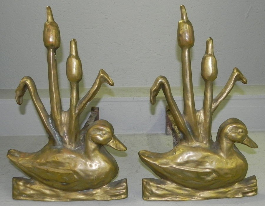 407: Pair of solid brass duck andirons. Very heavy.