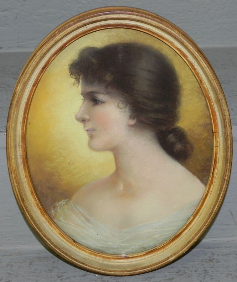 460: Pastel drawing of young lady in oval frame.