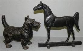 693 2 cast iron door stops Scottie dog  horse