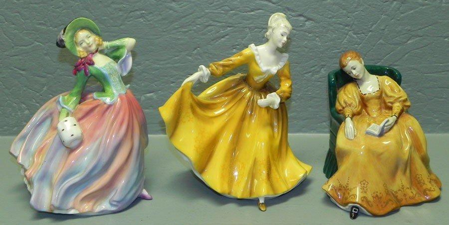 16: (3) Royal Doulton figurines.