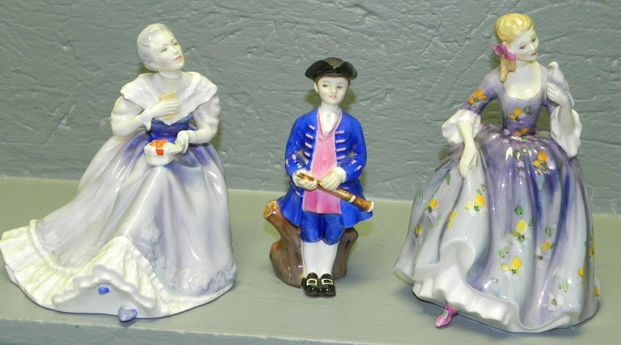 17: (3) Royal Doulton figurines.