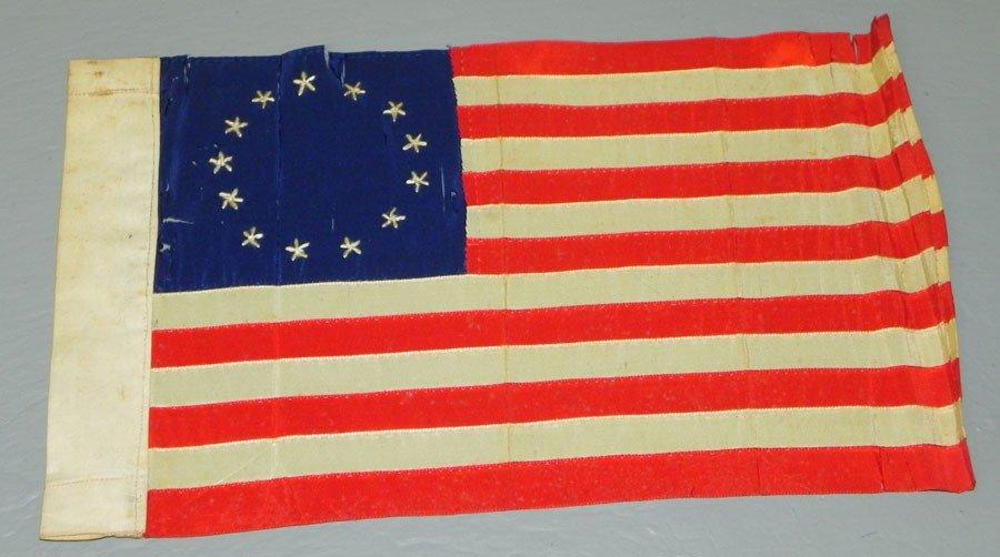 23: Miniature 13 star flag.