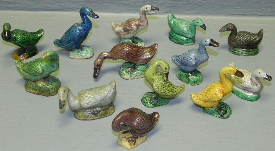 32: 13 miniature goose figurines.