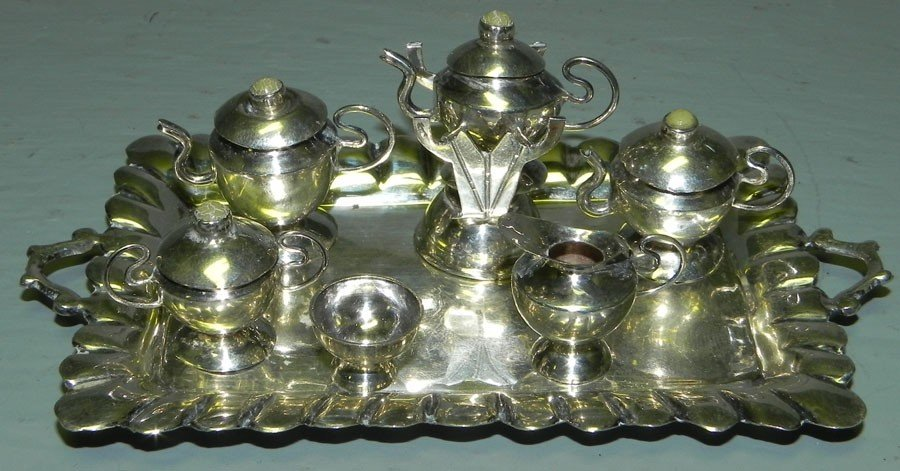32A: Miniature  sterling silver tea set.
