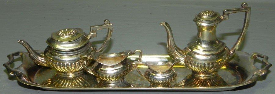 35: Miniature English sterling tea set.