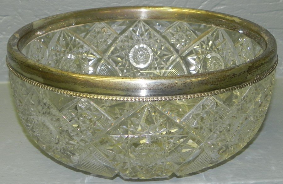98: Brilliant cut glass bowl with sterling rim.