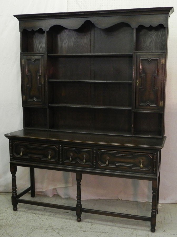 145: English oak turn of the century pewter cabinet.