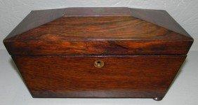 "6: Rosewood tea caddy. 11"" w x 5 1/2"" d x 6"" h."