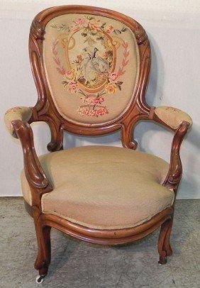 12: Beautiful needlepoint walnut Victorian arm chair.