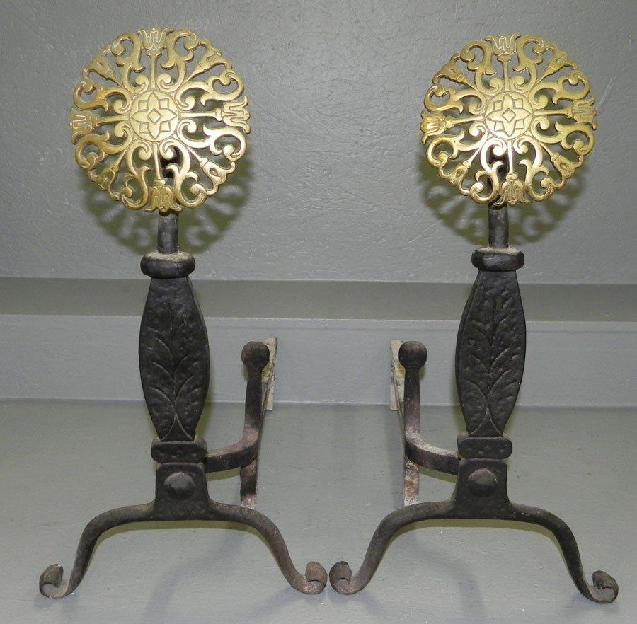 14: Pr. wrought iron andirons w/ brass sunburst front