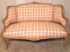 16: Carved French fruitwood settee.