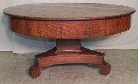22: Empire walnut round pedestal dining table.