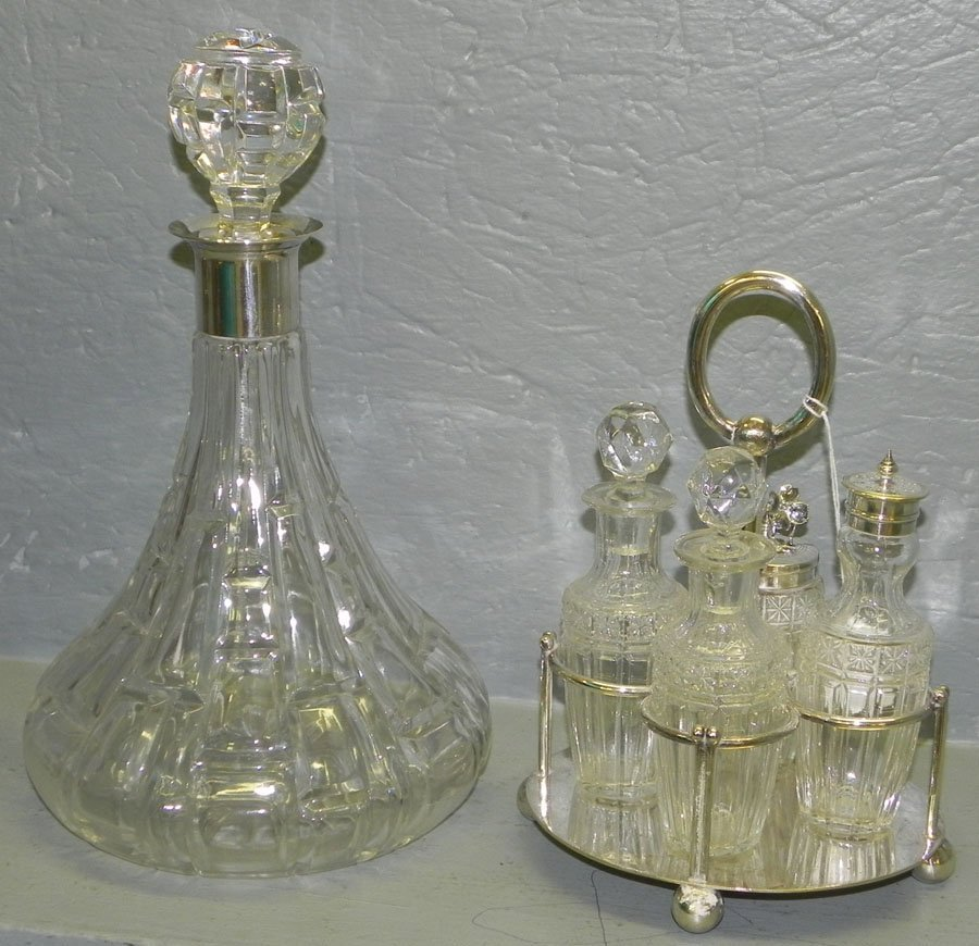 2: 4 bottle cruet set & silver topped decanter.