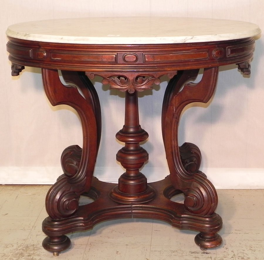 23: Very unusual oval marble top Victorian table.