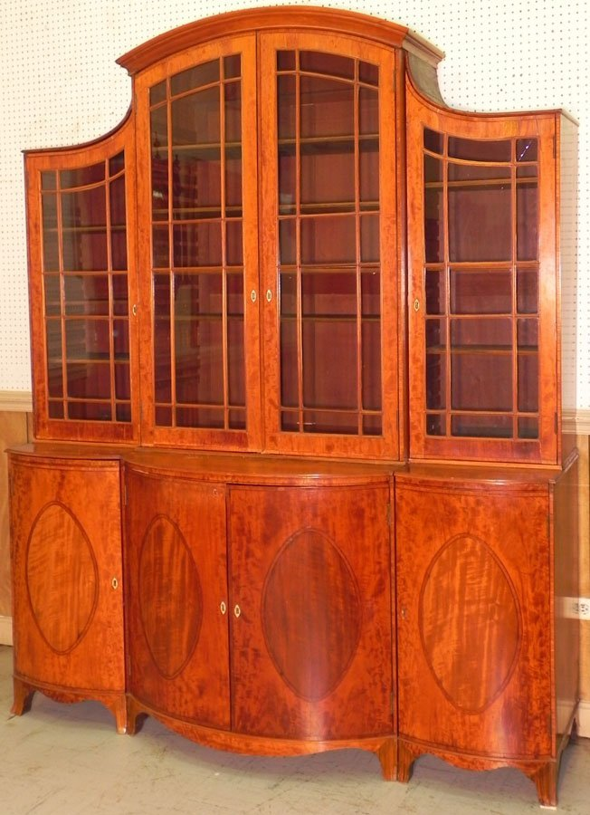 405: 19th c. satin wood breakfront w/chest in base.