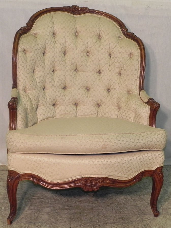 14: Carved tufted fruitwood arm chair.