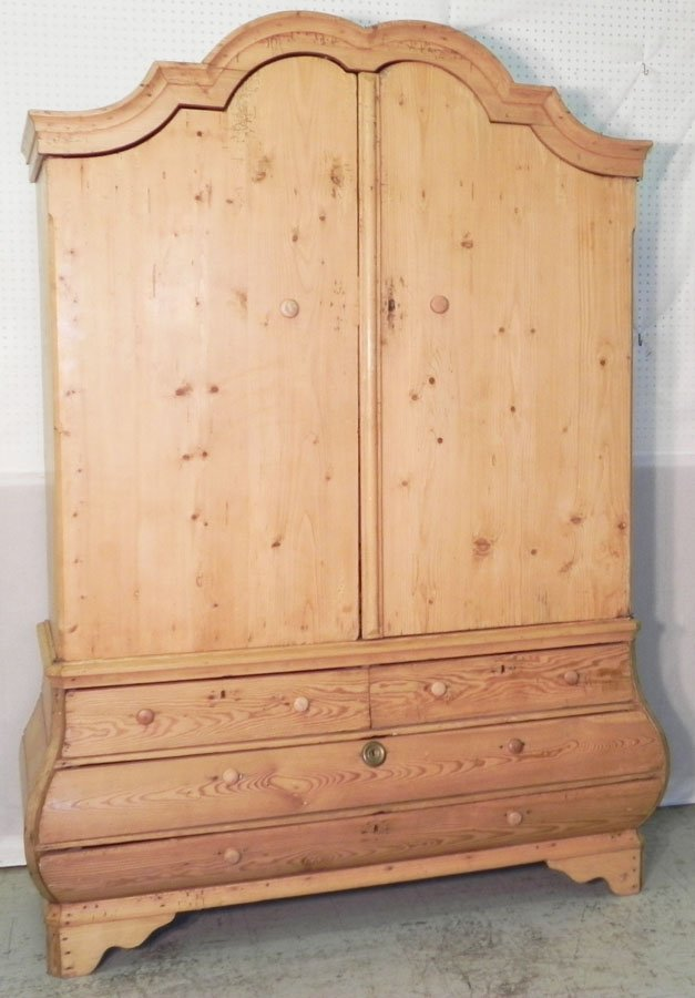 21: 18th c. Dutch pickle pine bombe linen press.